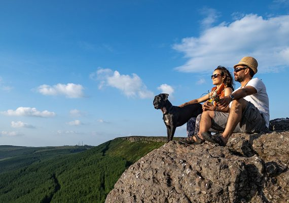 Image of Couple sitting with dog on birchill loop